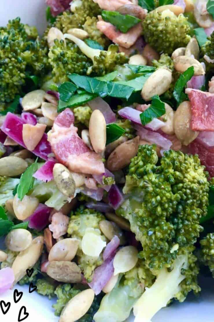 Easy lightly dressed broccoli salad with bacon and pumpkin seed.